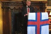 Høgni Hoydal, fiskimálaráðharri, luttikið á flaggdagshaldi í London